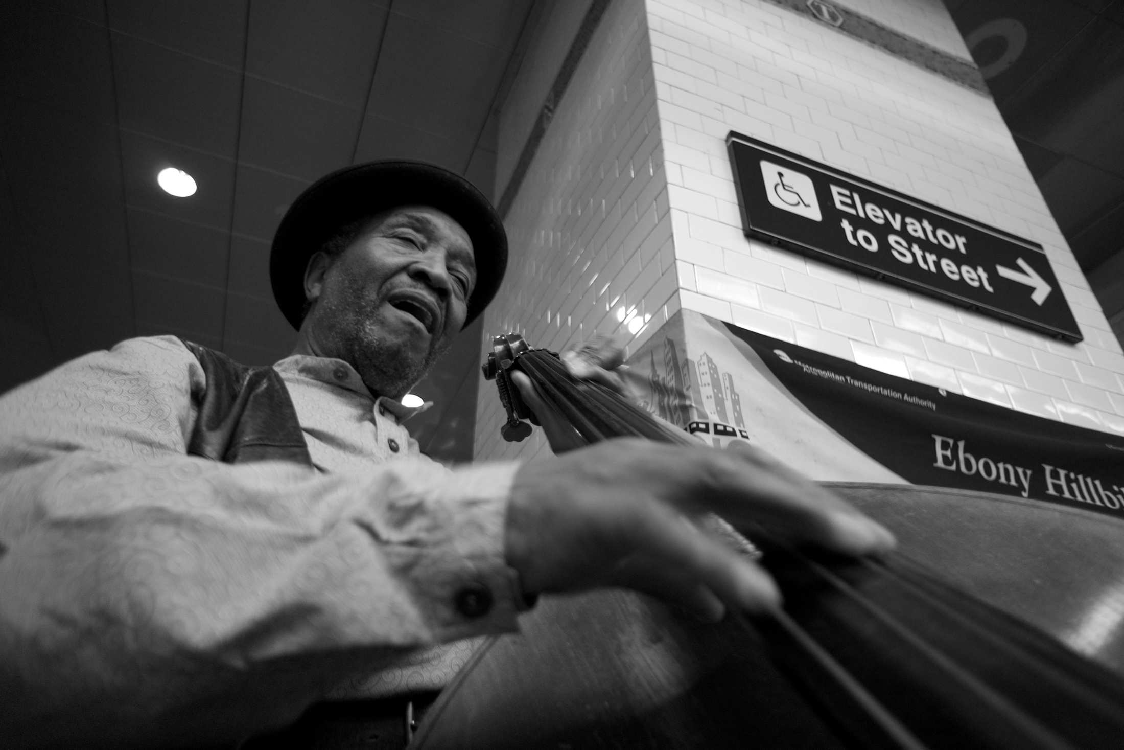This bassist was part of a three-man band playing on a New York City subway platform.