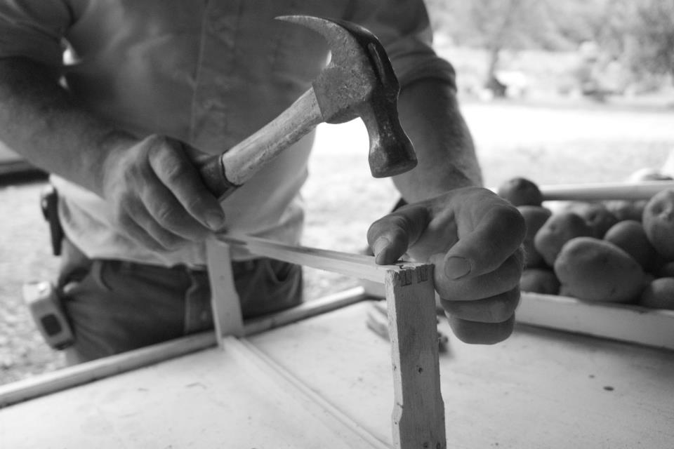 Paul Edwards building a shelf for a fruit stand (Lindon, TN)